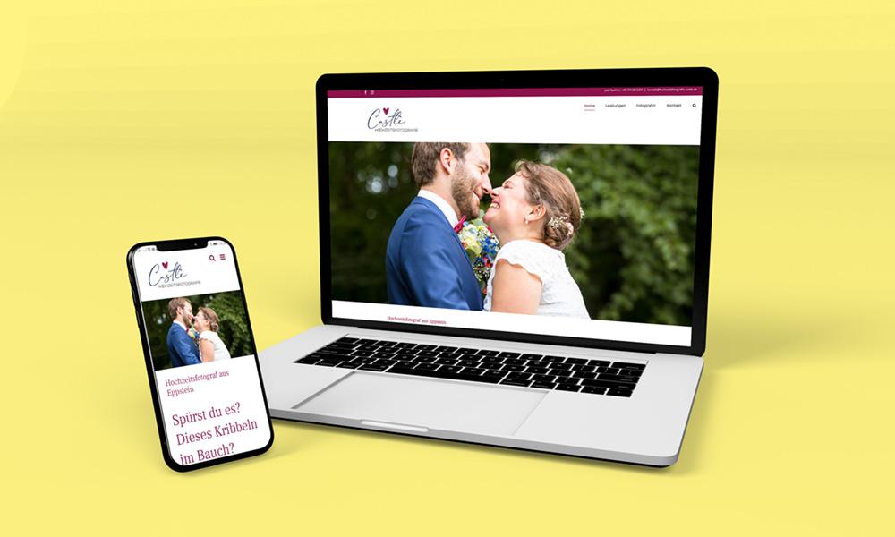 Laptop mit Webseite Hochzeitsfotografie Castle auf gelben Hintergrund